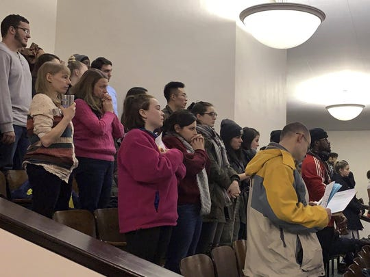 In this Tuesday, Jan. 22, 2019 photo, members of the public fill the seats at a meeting of the Binghamton school board in Binghamton, N.Y. Community members packed the meeting to demand answers after reports circulated on social media that four girls were strip-searched by the school nurse and assistant principal at a Binghamton middle school because they seemed giddy in the lunch room.