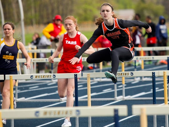 Marine City's Hannah Coverdill competes in the high hurdles during a track meet in the 2014 season at Port Huron Northern High School.