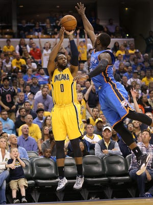 Indiana Pacers guard C.J. Miles threw up a three-pointer over Oklahoma City Thunder guard Dion Waiters (23) in the second half of their April 12 game.