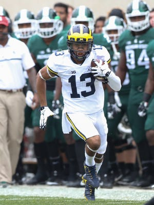 Michigan Wolverines RB Eddie McDoom runs the ball against the Michigan State Spartans during the first quarter on Saturday, Oct. 29, 2016 at Spartan Stadium in East Lansing.