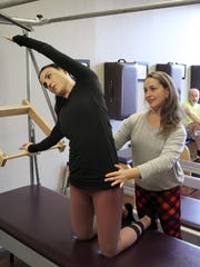 Sandi Vilacoba (right), owner of the Pilates Project,