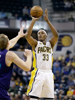 Indiana Pacers center Myles Turner (33) puts up a three-point shot in the first half of their game Monday, December 12, 2016, evening at Bankers Life Fieldhouse.