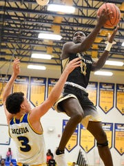 Treasure Coast's Tyrec Thompson (0) gets past Osceola's Jeremiah Palermo (3) for a fast break layup Tuesday, Feb. 27, 2018, during their high school Region 2-9A semifinal basketball game at Osceola High School in Kissimmee. Osceola defeated Treasure Coast 68-38. To see more photos, go to TCPalm.com.