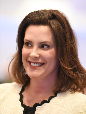 Senate Minority Leader and Democratic Gubernatorial candidate Gretchen Whitmer speaks to the press after the 2018 Annual Convention Gubernatorial Forum in East Lansing Thursday, May 10, 2018.   [AP Photo Matthew Dae Smith via Lansing State Journal]