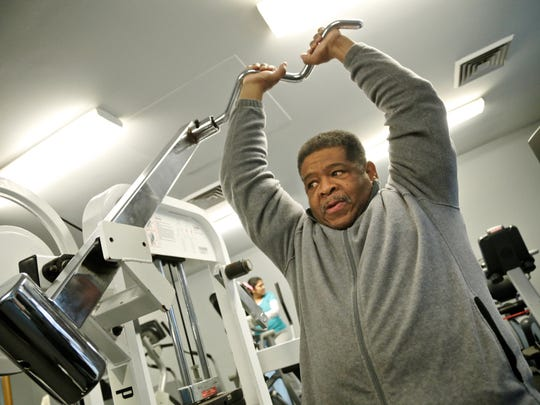 James Robertson, 57, exercises at the fitness center in his apartment complex.
