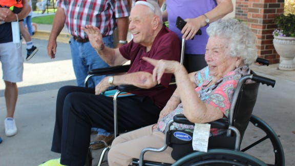 Charlie Martin, a WWII veteran, enjoys a drive-by celebration for his 100th birthday with his wife, Mary. Kim Archer/ Examiner-Enterprise