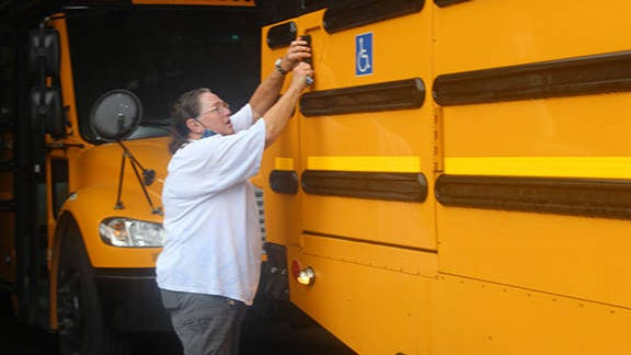 Bartlesville Public Schools driver Susan Ball demonstrates her pre-check routine before she picks up children for school every day. Kim Archer/Examiner-Enterprise