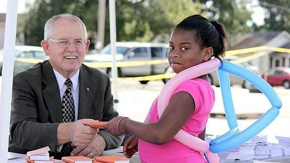 Herman Keisler (left) enjoyed handing out New Testament Bibles to people, especially children. He's pictured here at an event in Williston several years ago.