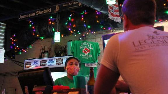 Stafford's Public House bartender Amanda Alexander speaks with a customer on Thursday, June 4. According to the Georgia Department of Labor the Chatham County leisure and hospitality sector gained 3,500 jobs from May to June.