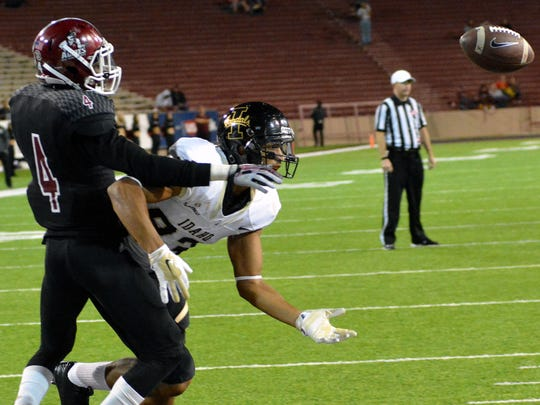 New Mexico State cornerback Winston Rose breaks up a pass in the endzone preventing an Idaho touchdown at Aggie Memorial Stadium on Saturday.