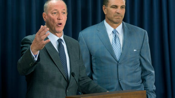 Former Buffalo Bills quarterback Jim Kelly speaks during a news conference on daily fantasy sports as former New York Jets quarterback Vinny Testaverde listens on Tuesday, June 14, 2016, in Albany, N.Y.  (AP Photo/Mike Groll)