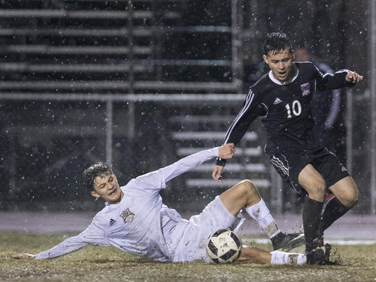 Tulare Union's David Gallegos, left, slide tackles