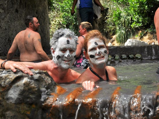 Eric and Pam Maunz  in mud baths in St. Lucia.
