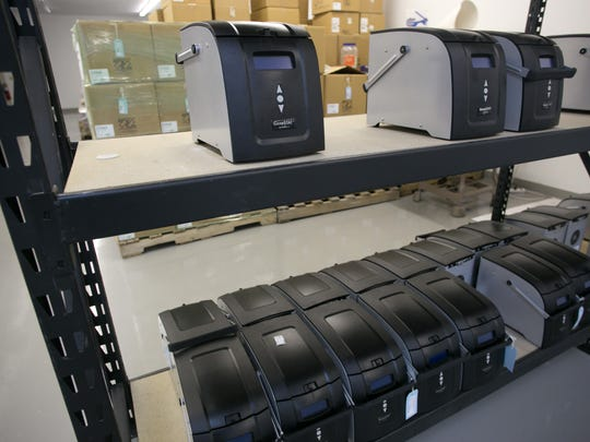 Rows of GeneSTAT machines wait to be shipped to customers