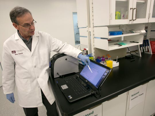 DxNA chief operating officer Ernie Sumsion explains the results from a test run in his company's GeneSTAT machine as they appear on the screen of a laptop in DxNA's St. George lab Wednesday, June 5, 2013.