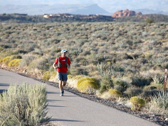 Cory Reese runs on the bike trail last year beside