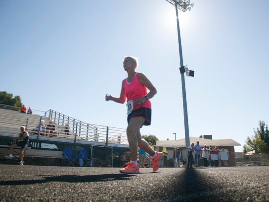 Dottie Gray runs on the track at Snow Canyon High School