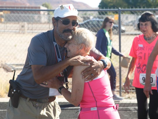 Dottie Gray gets a hug from track official Robert Archuleta