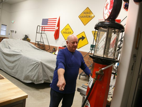 John Hansen shows off the gravity-fed antique gas pump