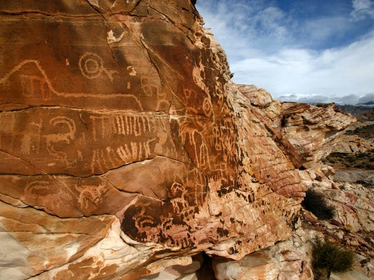 Petroglyphs cover a boulder at the Falling Man Petroglyph site in Gold Butte near Mesquite.