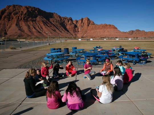Girls on the Run participants rtalk about their emotions and how best to deal with them during a pre-run lesson at Vista Elementary School in Ivins Wednesday, Jan. 27, 2016.