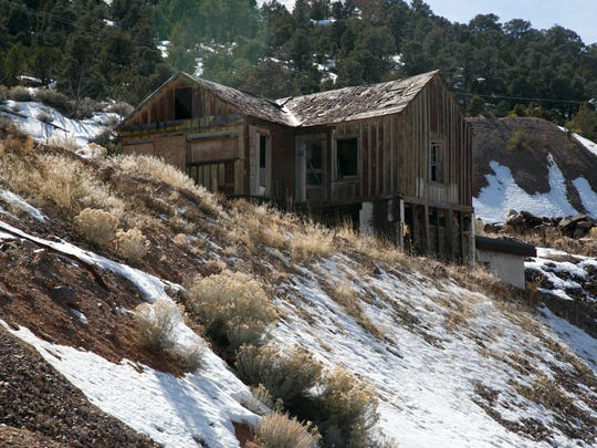 An abandoned building stands in the hills above Pioche, Nevada.
