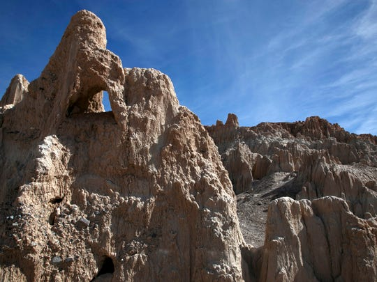The towers of sediment found in Cathedral Gorge State Park near Panaca, Nevada were created by the erosion of sediments from an ancient lake that were left in the valley floor and then washed away by rains and flash floods.
