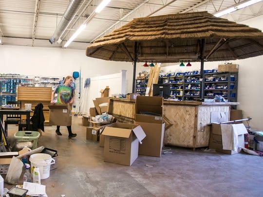 Taylor Eisenhart, of Spring Grove, organizes boxes