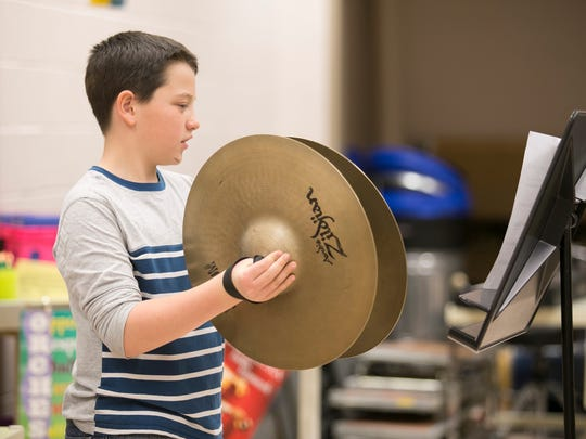 "Sixth-grader Braiden Burns, plays the cymbals during band practice Wednesday, March 16, 2016, at Spring Grove Intermediate School. The fifth- and sixth-grade band, will play ""Tears of Arizona"" publicly for the first time during a concert, held at the school on March 31, and then again in Washington D.C in May. Amanda J. Cain photo"