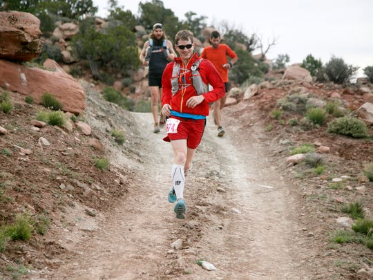Runners makes their way along the Flying Monkey Trail above Virgin early Friday, April 8, 2016 during the Zion 100 ultra marathon trail race.