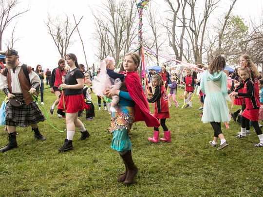 Youths participate in the maypole dancing at the 25th Annual Fairie Festival Saturday, April 30, 2016, at Spoutwood Farm in Codorus Township.  Amanda J. Cain photo