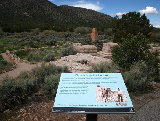 Interpretive signs dot the landscape at the site of