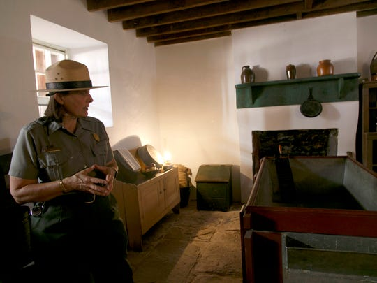 Park Ranger Julie Benson describes how the pioneers made cheese in the basement of Winsor Castle during a tour of the historic fort on the grounds at Pipe Spring National Monument in 2016.