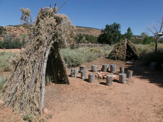 Paiute shelters stand on display on the grounds of Pipe Spring National Monument.