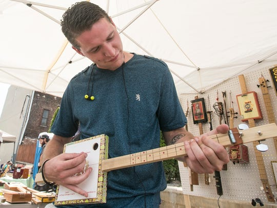 Kevin Kropp, of York City tries out a acoustic 2-string