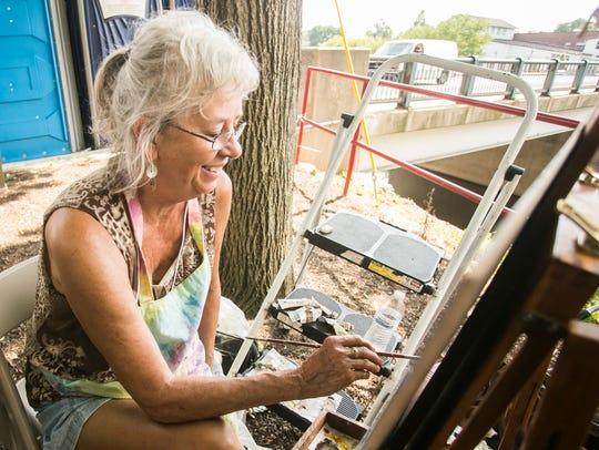 Mary Ann Vessey, of Staunton, Virginia paints next