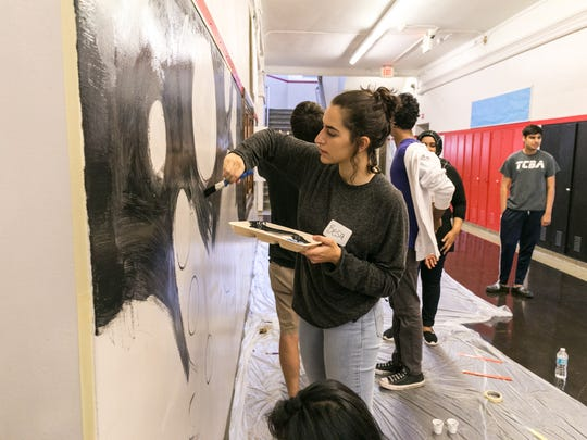 Jews and Muslims sponsored by the Jewish Community Relations Council and the Michigan Muslim Community Council come together to brighten Nolan Elementary-Middle School in Detroit, Sunday, September 18, 2016.