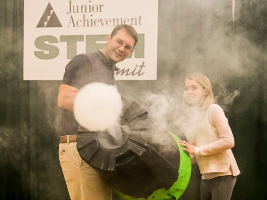 Ninth-grader Madison Galloway, right, and volunteer Eric Meisenhelder watch as their air cannon shoots out smoke to demonstrate air movement during the STEM Summit Wednesday, Dec. 7, 2016, at Red Lion Area Senior High School. Amanda J. Cain photo