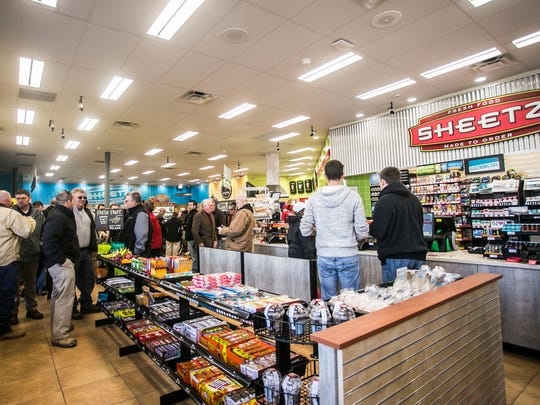 Customers gather in the new Sheetz, located at 160 Leader Heights Road in York Township,  Thursday, Dec. 22, 2016. This was the last of three store openings in the region. Amanda J. Cain photo