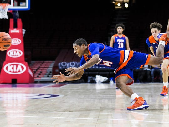 Jasere Drayden dives for a loose ball against Steel-High in a game at the Wells Fargo Center last season. Drayden is one of two seniors on this year's Bearcats' team that saw significant minutes in 2016-17.