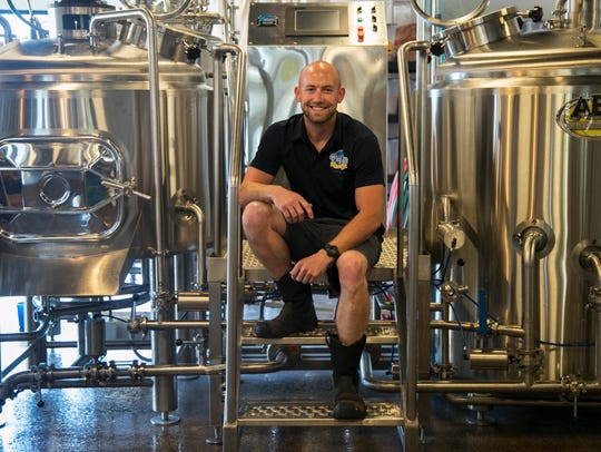 Logan Hemphill is the head brewer for Big Blue Brewing