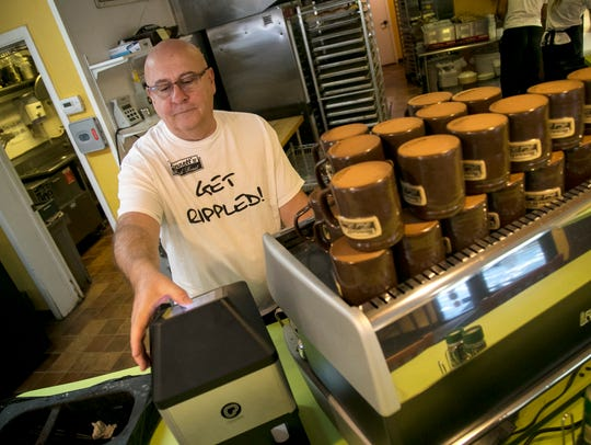Bob Grissinger, owner of BennettÕs Fresh Roast, puts