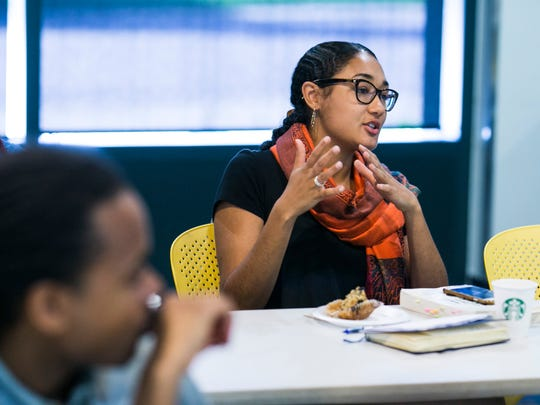 Monique Becker, 23, a development associate at The Platform, answers a question from students while assisting in a real estate essentials class on June 10, 2017 at the University of Michigan Detroit Center in Midtown. The course is part of the Better Buildings, Better Blocks grant through The Knight Foundation.