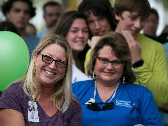 Nadine Maki smiles at a funny story about her son Erik Babatz at his Gift of Life ceremony on Tuesday at Lee Memorial Hospital.
