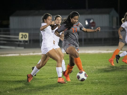 Alondra Castillo of Lely looks to pass in the Region 3A-4 girls soccer quarterfinal game on Tuesday, Feb. 6, 2018, in Cape Coral.