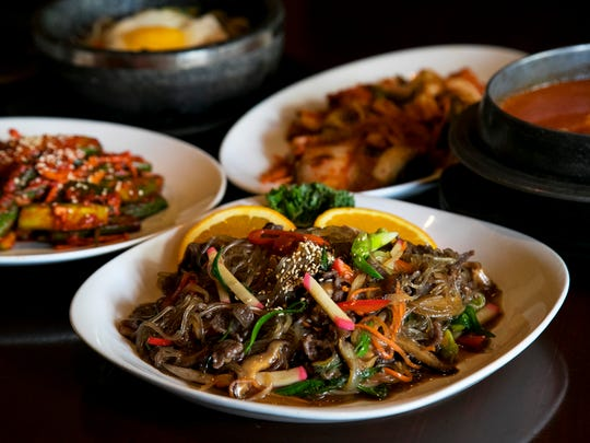Japchae, center, a Korean dish of stir-fried glass noodles, iks popular during Lunar New Year. Long noodles are said to bring long life.