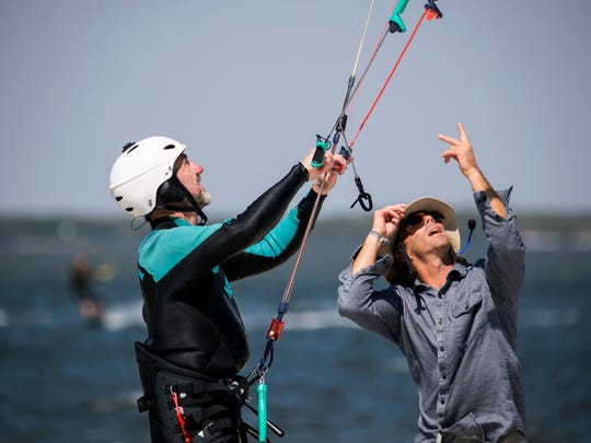 Andreas Wolff, who is on vacation from Germany, gets kiteboarding instruction from Kellen Hall on Wednesday at the Sanibel Causeway.