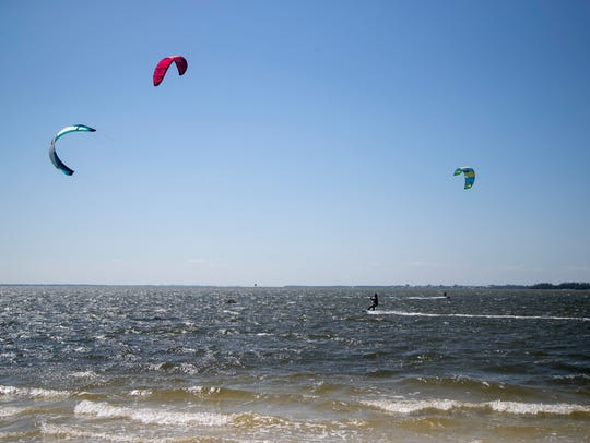 Kiteboarders flock to the Sanibel Causeway during a