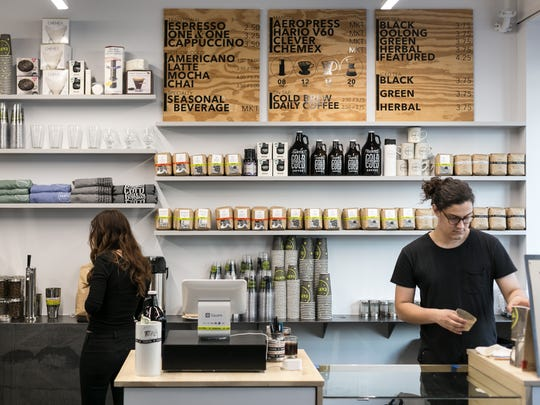 Cartel Coffee Lab in downtown Phoenix is a small space that features a to-go window and shared communal area.