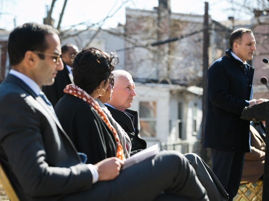 Mayor Mike Purzycki listens as Robert Buccini, Chairperson of the Wilmington Housing Partnership, speaks at a demolition of a series of nuisance and abandoned properties in the area of 8th and Bennett Streets on the Eastside of Wilmington. The demolition will make way for the construction of new owner-occupied town-homes as part of a larger neighborhood revitalization of the east side.